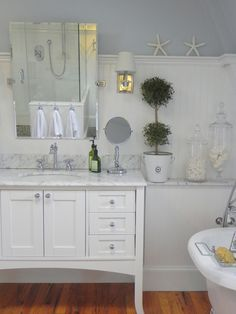 Image from http://www.snoozh.com/wp-content/uploads/2015/03/furniture-spellbinding-fairmont-designs-bathroom-vanity-shaker-with-carrara-marble-top-under-wall-mounted-bathroom-mirrors-on-white-beadboard-wall-panels-above-varnished-hardwood-floor-545x726.jpg.