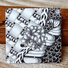 Tile by Lily M. / Lily's Tangles using the Tangle Pattern: Narwal.