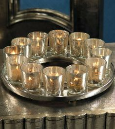 The unique Antique Nickel Candle Holder adds ambience to any side, umbrella, or dining table of your choice.