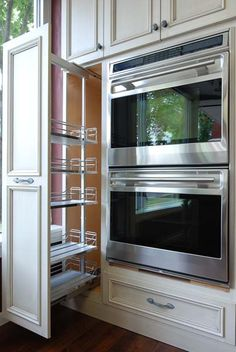 Pull out pantry system. Put next to double oven? Will heat be a problem?
