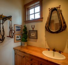 Phenomenal Western Decor Ideas For Living Room for Powder Room Farmhouse design ideas with Phenomenal bathroom mirror bridle Horse Bathroom, Western Bathroom Decor, Rustic Bathroom Mirrors, Western Bathrooms, Bathroom Mirror Design, Vanity Wall Mirror, Rustic Bathroom Designs, Rustic Bathrooms, Wood Bathroom