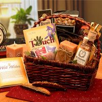 """Wellness Wishes Get Well Gift   An absolutely gorgeous gift basket filled to overflowing with heartfelt wellness wishes. The wonderful """"Touch of Wellness Wishes"""" gift book is filled with cheerful stories of personal triumph and uplifting stories. We've included an aromatherapy candle, chocolate drizzled biscotti and more delicious gourmet treats to fill their senses along with their bellies. A very upscale and lovely get well gift basket!"""