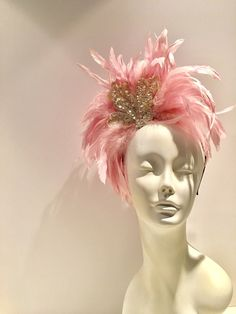 A personal favorite from my Etsy shop https://www.etsy.com/listing/507606007/pink-fascinator-pink-headdress-kentucky