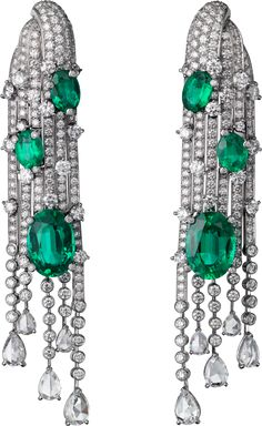 CARTIER. Earrings - white gold, six oval-shaped emeralds totaling 12.80 carats from Brazil and Zambia, pear-shaped rose-cut diamonds, brilliant-cut diamonds.
