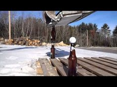 Bobcat Ninja out of New Hampshire uses an Excavator to carefully stack beer bottles on top of each other. If that isn't impressive the guys top it off with a golf ball. Surprisingly the 'Excavator Trick' only took one shot.