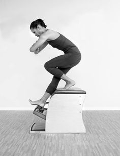 CLIMB DOWN THE MOUNTAIN:  I know this first exercise as Climb Down the Mountain on the Wunda Chair. I love this exercise because it isn't about what is moving, rather more about what isn't moving. When done well, the whole body is working. The hips are steady and aligned, while the pedal is being pumped.  Blossom Leilani Crawford | www.bridgepilates.com   Image Courtesy of PILATESOLOGY Chair Exercises, Comfy, Living Room Furniture, Desk, Style, Home Decor, Writing Table, Swag, Homemade Home Decor