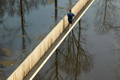 The concept behind the Invisible Bridge Road is simple; to give people the illusion of being able to walk through water.