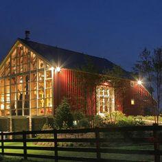 A modern barn home with window-framed gable end.