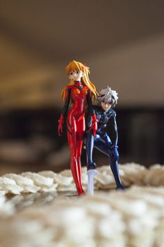 This is what happens when a Japanese studies PhD candidate ties the know: Evangelion anime wedding cake topper straight from Akihabara!