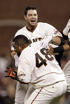 San Francisco Giants Brandon Belt, top, is hugged by teammate Pablo Sandoval (48) after Belt drove in the game-winning run against the Arizona Diamondbacks in the bottom of the ninth inning of a baseball game on Monday, April 22, 2013 in San Francisco