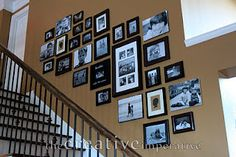 Aiming for photos like this on our staircase, but various woods, not black frames.  Now I'm thinking I should have gone for black!