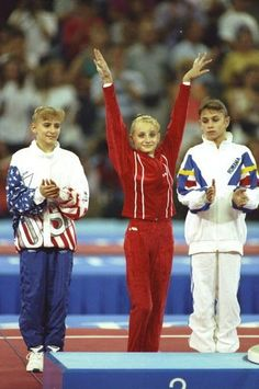 1992 Olympic AA Champion Tatiana Gutsu of Ukraine, Silver Medalist, Shannon Miller of the U.S.A. and Bronze Medalist Dominique Dawes of the U.S.A.