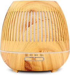 Beautiful diffuser in wood look for your essential oils.  With timer and Ultrasonic Cool Mist Humidifier with Auto Shut-off Function ideal for the bedroom. Available on Amazon. #ad