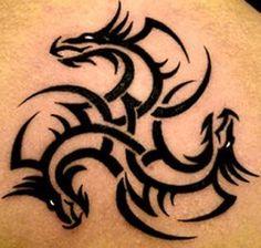 A tribal tattoo that uses three dragons heads to create a spiral design « « Ratta Tattoo