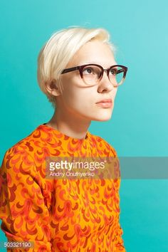 Girl Wearing Glasses Stock Photo | Getty ImagesGirl wearing glasses caption: Portrait of blond girl wearing glasses and orange sweater. She is looking up with hope. Shot in studio on blue background. link: http://www.gettyimages.com/detail/photo/girl-wearing-glasses-royalty-free-image/503321190