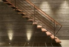 Perfect use of lighting on concrete wall & staircase. Modern, sleek, industrial.