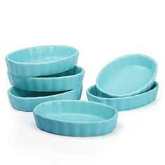 START PANE Overview Sweese is mixed the classic scalloped design with an oval shaped ramekin, adding a modern touch to your table. These shallow ceramic dishes absorb and distribute heat evenly, performs a seamless transition from the oven to the table. More Details Color: White, Navy, Turquoise, RedMaterial: PorcelainSet of 6Size: 4 ounce, 4.7 x 3.2 x 1 inches Use Microwave, dishwasher, oven safe Lead free, food safe Perfect for bread pudding, flan and crème brûlée Care To clean, simply wipe wi Kitchen Torch, Kitchen Pantry, Kitchen Dining, Creme Brulee Ramekins, Quiche Dish, Souffle Dish, Turquoise Kitchen, Lavender Honey, Oven Racks