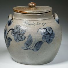 """Jeffery Evans. 4/5/14. Lot 14. COFFMAN FAMILY, SHENANDOAH V. OF VA. DECORATED STONEWARE SQUAT JAR & COVER, salt-glazed, compressed bulbous form. Neck ring, plain rim & arched handles, with cover. Incised, cobalt """"Blackbury"""" (sic) in script. Brushed & slip-trailed 5 petal floral sides. Attr. to Andrew Coffman (1795-1853) or his sons, probably @ Beldor pottery near Swift Run Gap, Rockingham Co. C. 1845-1860. 8"""" HOA, 5 1/4"""" D rim. Outstanding condition. 1 1/4"""" hairline on back rim, cover rim…"""