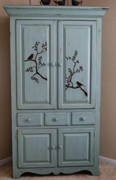 This was a TV cabinet...repainted, stenciled and great for storing quilts!