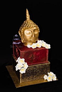 Buddha frangipani cake. wouldn't use the buddha, but the layers and flowers are stunning