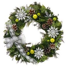"Preserved leaves and green cedar wreath with frosted pinecones, ornaments, snowflakes and a sheer white ribbon in a natural twig base.  Product: WreathConstruction Material: Silicone and natural twigColor: GreenDimensions: 18"" DiameterCleaning and Care: Wipe gently with a dry cloth. Avoid sunlight and humidity."