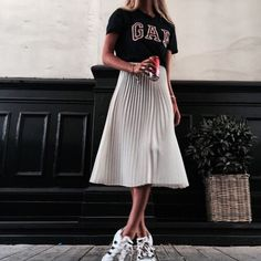 My favourite way to dress down a pleated midi skirt (which are an absolute smash hit this season- thanks to Gucci). Wear with a retro slogan or branded tee for a cute 90s take and finish with white trainers for extra comfort.