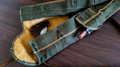 Canvas and leather carry bag for an ax, knife and bucksaw.