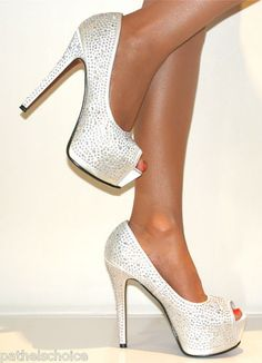 wedding shoes....i have these in black! may have to wear them to go with my purple and black