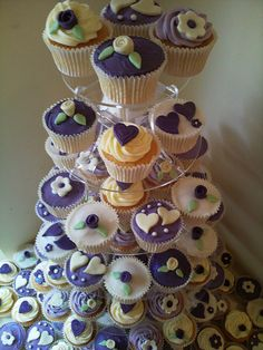 African Violet and Ivory Wedding Cupcakes by Melinda's Fantasy Cupcakes, via Flickr