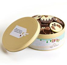 """Little Christmas puds and pretty bunches of holly adorn these delectably chunky chocolate discs. Each one is lovingly decorated to bring out the festive cheer. The chocolates won't last long, but the personalised keepsake tin will last a lifetime. """"Wishing you a very happy Christmas"""" will be printed on the label as well as your personal message.   ##### Includes:  4 Milk Chocolate Christmas Pudding Discs 4 White Chocolate Holly Discs 2 Dark Chocolate Christmas Pudding Discs 2 Dark Chocolate…"""