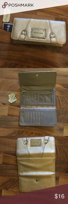 **Franco Sarto** Wallet ***Franco Sarto Gold Wallet*** wth lots and lots of inner card compartments. Excellent condition. Brand new with tag. No Trades. Franco Sarto Bags Wallets