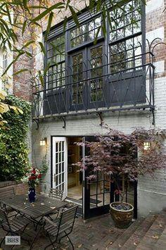 Townhouse ok my next house ... Open Patio/grass area off kitchen.