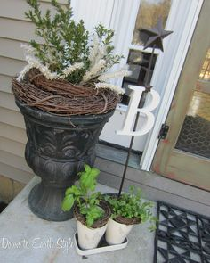 Front porch decor -love the planter. We need a more welcoming front porch