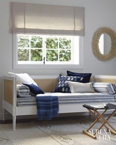 Living room idea: layers of pillows in shades of blue on a daybed make for an inviting space to unwind - Serena & Lily Rattan Daybed, Outdoor Daybed, Daybeds, Reading Room Decor, Game Room Decor, Daybed Design, Minimalist Rugs, Coastal Living Rooms, Living Spaces