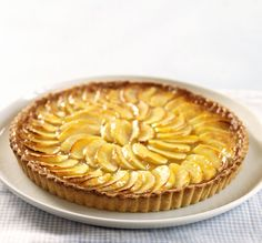 A classic French dessert you can make at home. Apple slices are baked on a layer of pastry cream in a sweet shell, then garnished with apricot glaze.