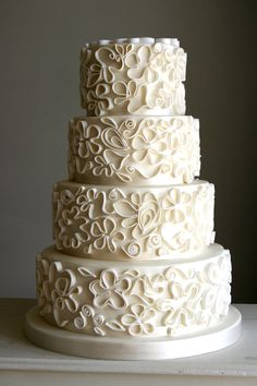 Sugar quilled wedding cake, taking pattern from brides lace dress. www.flutterby-bakery.com