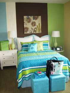 Another way to modernize stripes is to apply them in more of a color-block fashion. Choose different shades and paint each in a different width for graphic appeal. Even the comforter, with its own stripes and polka dots, feels young but modernized when set against this wall.