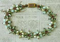 "Linda's Crafty Inspirations: Bracelet of the Day: Crystal Flower Bracelet - Aquamarine--CRYSTAL FLOWER BRACELET 15/0 seed beads Miyuki ""Dark Bronze"" (15-457D) 11/0 seed beads Miyuki ""Dark Bronze"" (11-457D) 4mm fire polished beads ""Aquamarine Celsian"" 4mm bicones ""Sea Foam"""