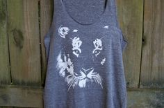Dream BIG!  My husband hand prints our Tiger design in white ink on a so-soft Eco-Heather-Blend Alternative Apparel tank top 50% polyester (6.25%