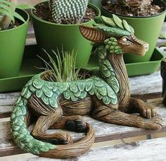 "Clever little dragon planter with juicy scales! ""Planters are in the shop! - Clever little dragon planter with juicy scales! ""Planters are in the shop! Clay Projects, Clay Crafts, Diy Clay, Garden Planters, Garden Art, Garden Design, Moon Garden, Succulent Planters, Ceramic Art"