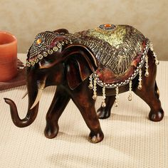 When nature's majesty combines with lavish finery, the Bejeweled Elephant Sculpture approaches a royal appearance. This resin table sculpture depicts a proud. Asian Elephant, Elephant Love, Elephant Art, Elephant Stuff, Elephant Gifts, Elephant Table, Elephant Home Decor, Elephant Decorations, Elephants Never Forget