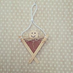 Cute baby in a manger ornament for preschoolers