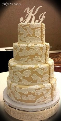 Lace and button wedding cake - CakesDecor