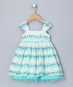 This charming dress features rows of aqua and blue flowers. The big bow can be tied in front or back to create varied looks that are simply stylish.Note: Infant sizes include a diaper cover.100% cottonMachine wash; tumble dryMade in th...