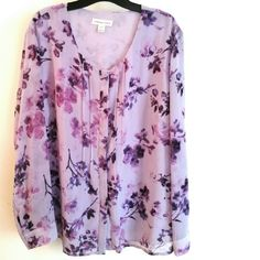 Coldwater Creek Purple Chiffon Floral Print 2X This Coldwater Creek Purple Chiffon Floral Print is a size 20/22 (brand tag 2X) in great used condition. Has a button down front hidden by pintucking details. Body is lined in plain violet chiffon. 100% polyester, no stretch. Bust measures 26 inches across laying flat, measured from pit to pit. 29 inches long. ::: Bundle 3+ items from my closet and save 30% off when you use the app's Bundle feature! ::: No trades. Coldwater Creek Tops Blouses