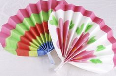 Make a Korean paper fan! This activity is a great way to help your child explore different cultures while she builds her fine motor and arts and crafts skills.