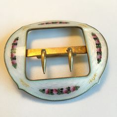 Gustav Gaudernack design for David Andersen. Silver gilt guilloché enamel belt buckle with painted rose motif. 1905-1910