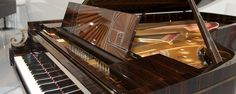"""When it came time to celebrate Steinway's piano, the company turned to furniture/interior designer Frank Pollaro who also designed the limited edition """"Rhapsody in Blue"""" for Steinway… Read Music Math, Rhapsody In Blue, Grand Piano, Spotify Playlist, Music Theory, Musical Instruments, Mathematics, Education, Beauty"""