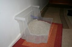 Home-made Perfect Litter Tray * I've been a bit careless with my litter tray etiquette. Sometimes I stand at the back of the litterbox, and wee, and well, I'm afraid most of it goes on the wall, and then down under the carpet! * Daddycat had an idea! He bought a big storage box, and cut half of it out, so if I do wee against the wall, it hits the box, and runs down! The front is cut away too, so I don't have to do an impression of a high-jumper to pole-vault into my litter! #cats #DIY