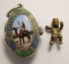 Silver & Enamel Opening Moses Basket & Baby Charm